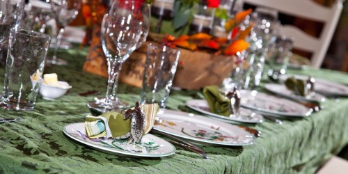 Picture of a dinner table set with pretty place settings