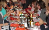 Picture of people sitting at a dinner table eating lobster